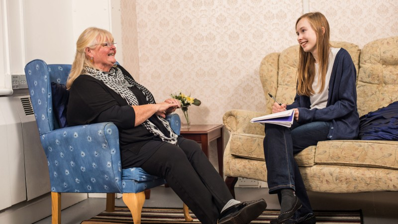 Service user and student talking