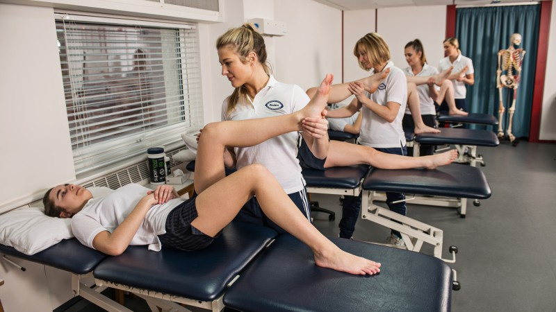 Students practicing Physiotherapy
