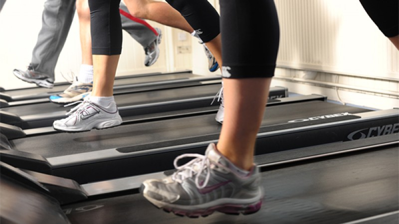 Images of people feet running on a treadmill