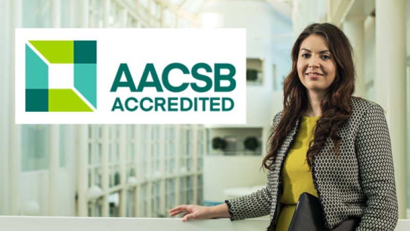 Bournemouth student Jamie Seager alongside the AACSB logo
