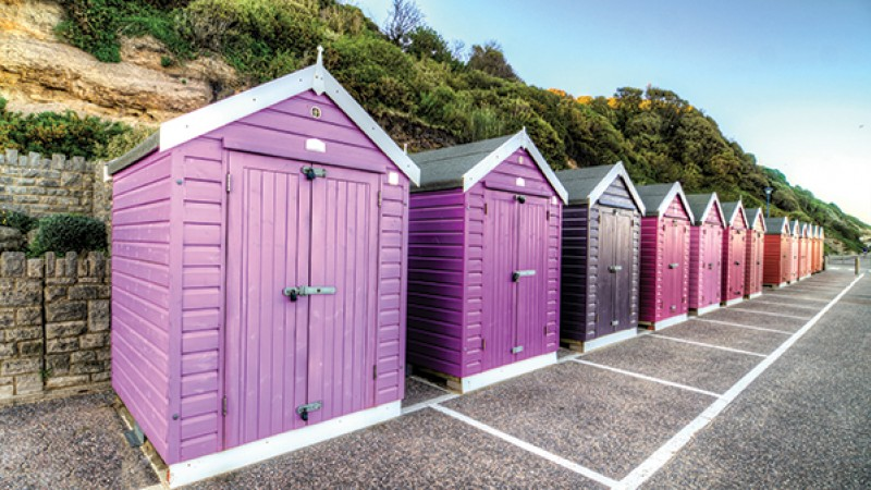 Multicoloured beach huts on Bournemouth prom