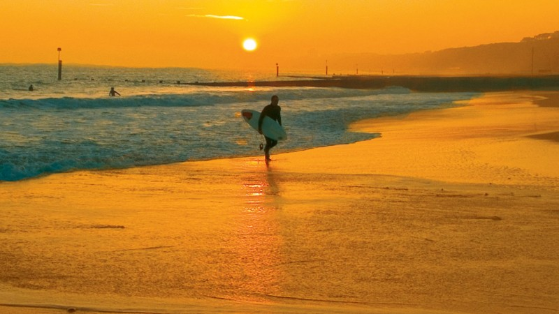 Bournemouth beach sunset surfer