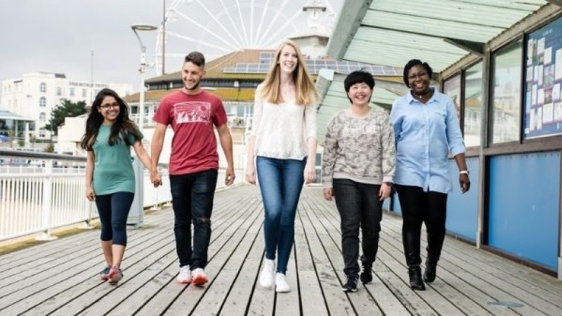 A group of students walking on Bournemouth Pier