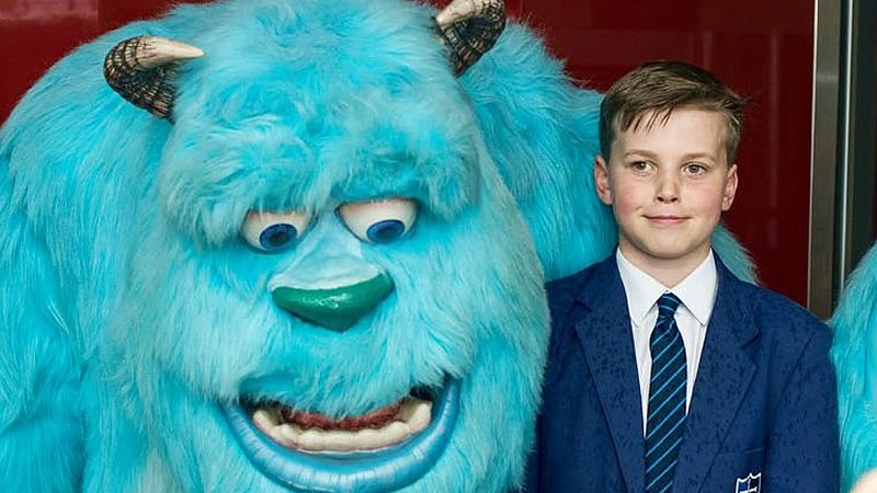 Student and a model of Sulley from Monsters inc