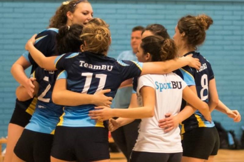 TeamBU students celebrating on the court