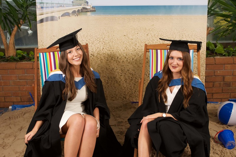 Graduating students on the BU beach