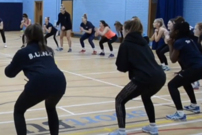 Image of performance netball team trying challenge
