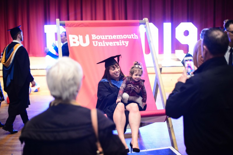 Graduation 19 - HSS Grad and daughter on deckchair