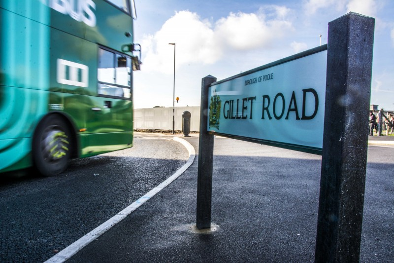 Road sign for Gillet Road with green UNIBUS