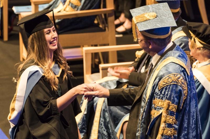 SciTech graduation - handshake
