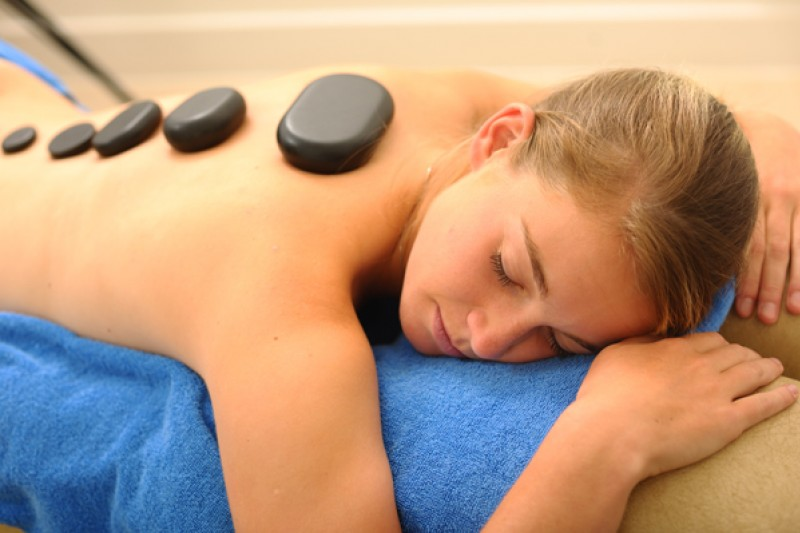 Image of a person with massage stones on their back