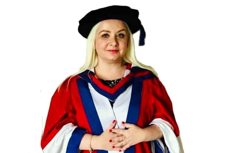 BU graduate's charity work acknowledged with honorary doctorate