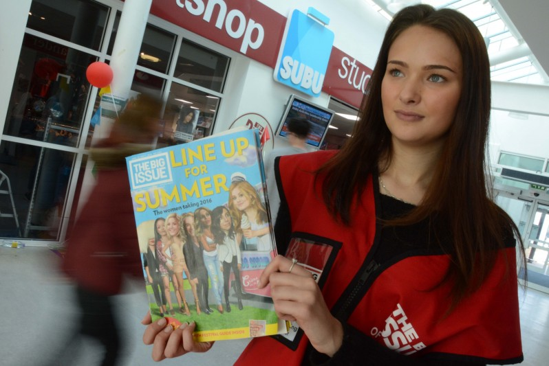 BU student sells copies of The Big Issue