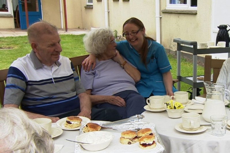 A carer with dementia patients