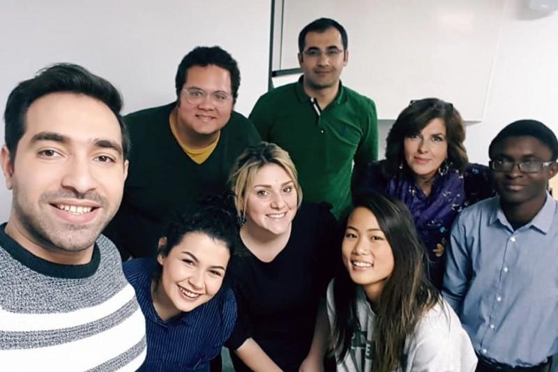 BU LLM students celebrate presentation success