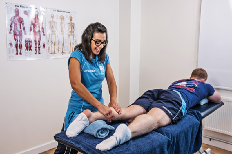 Image of a person massaging a leg