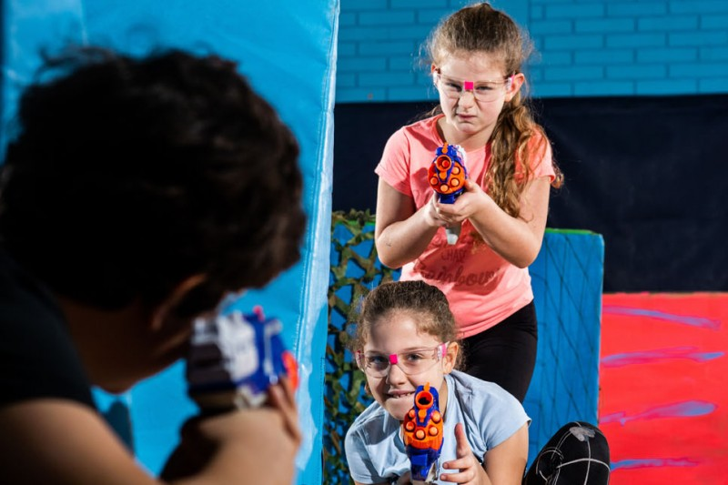 Our action-packed Neon Nerf Wars party sees children running and ducking for cover as they battle their way through the tunnels, camo nets and obstacles.
