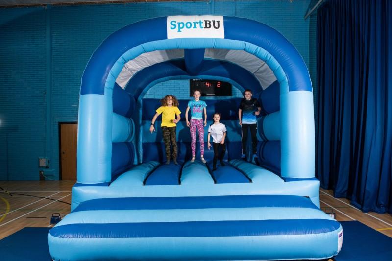 Children on a bouncy castle