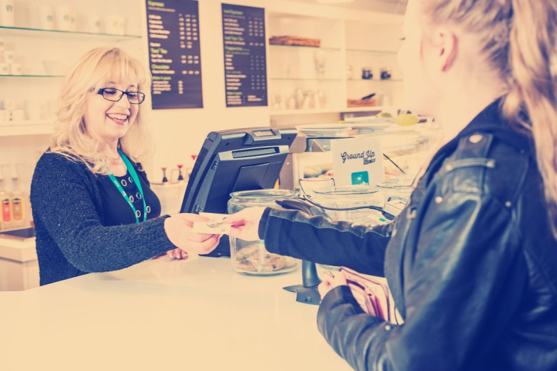 Student paying in coffee shop