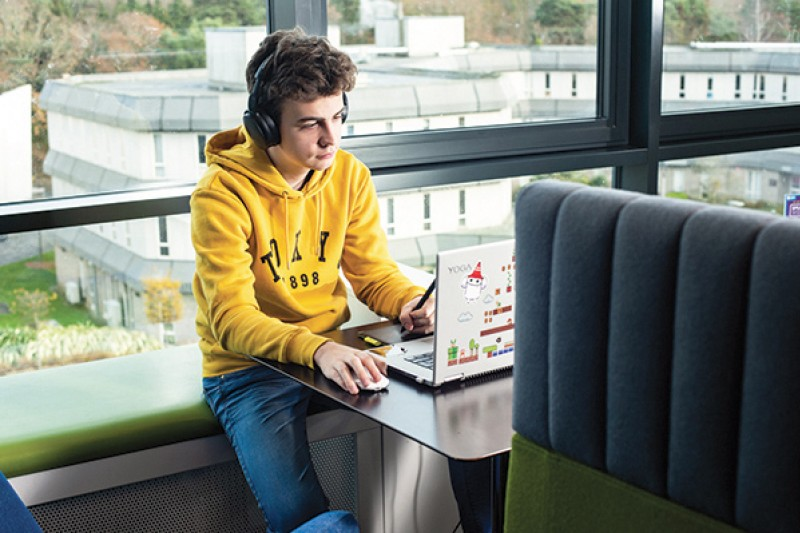 student using laptop in Student Centre