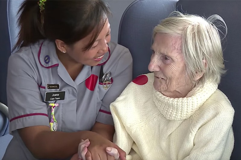 A dementia nurse with a patient in a care home