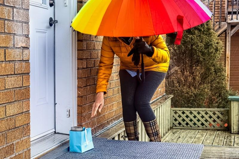 Carer dropping off food parcel