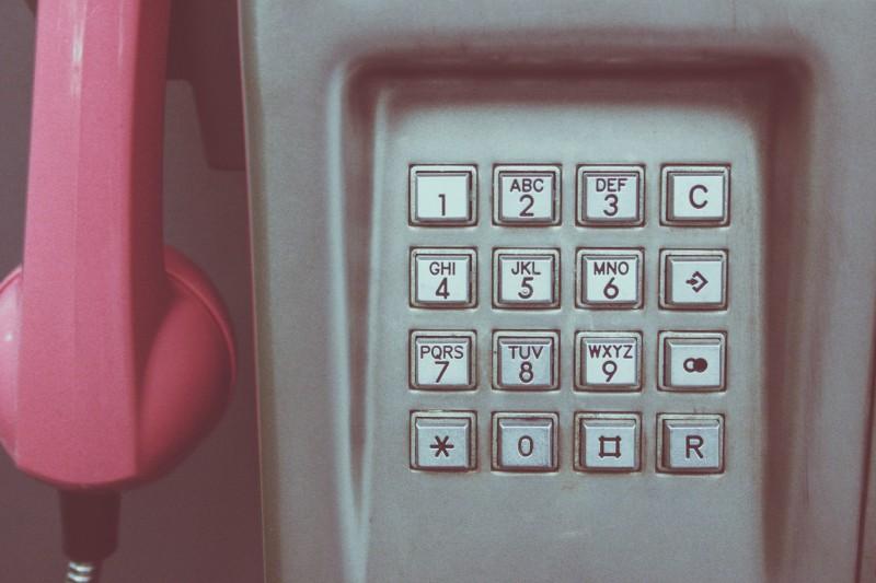 close up of a phone box key pad