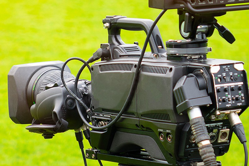 Image of a film camera against a green backdrop