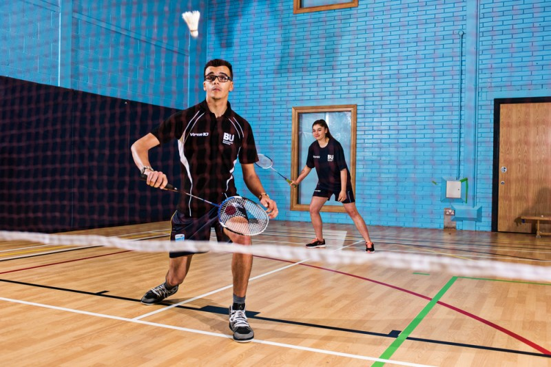 A badminton match in the Sports Hall