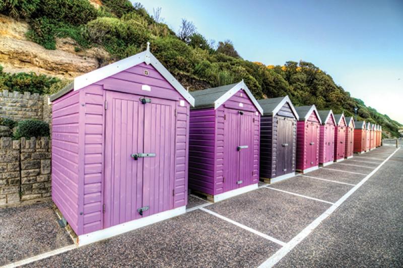 Multicoloured beach huts on Bournemouth prom