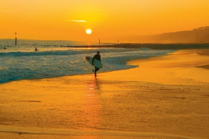 Bournemouth beach sunset surfer