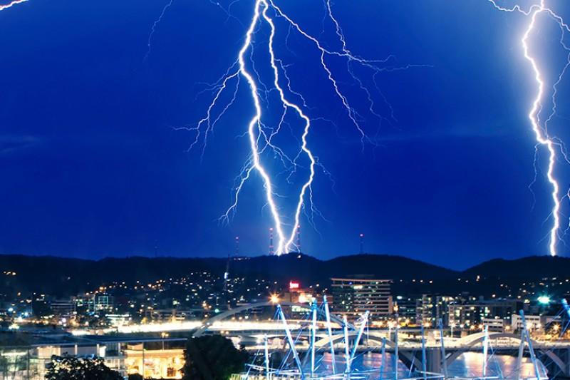 Lightning over a city at night