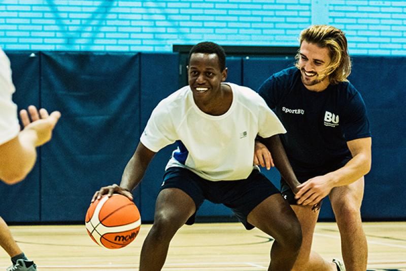 Image of people playing basket ball