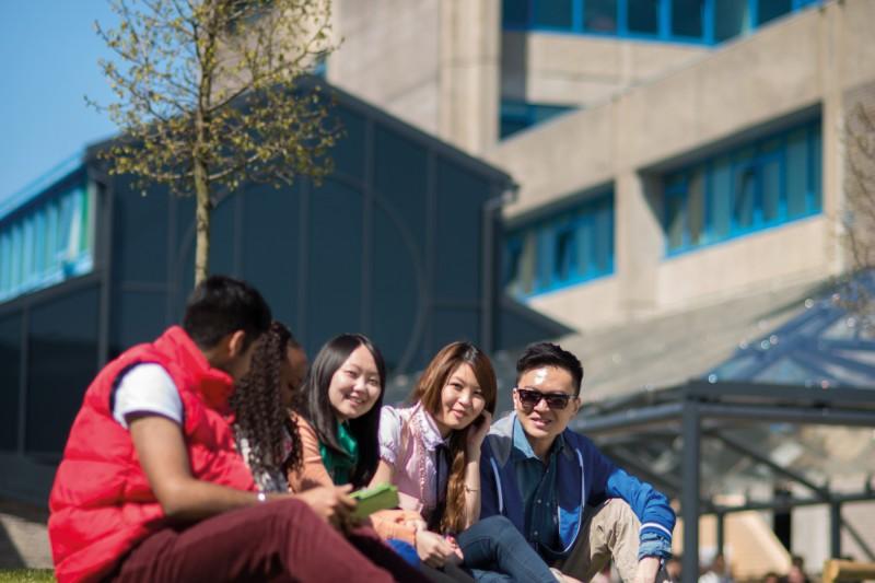 International students outside poole house