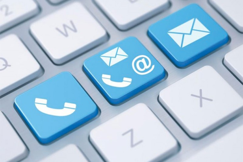 A keyboard with phone and email contact icons