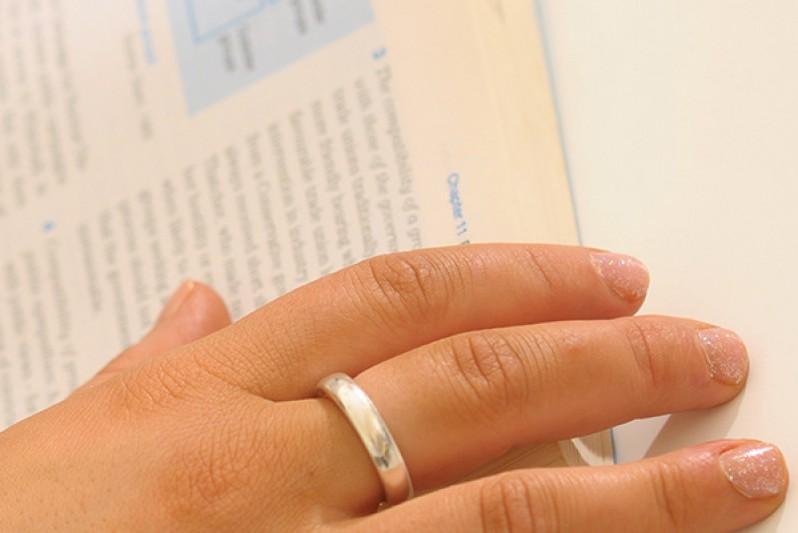 student reading textbook