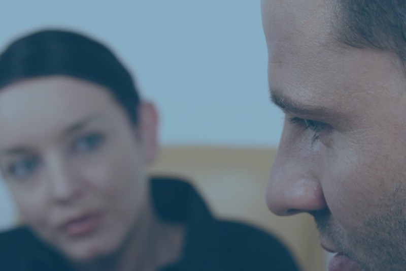 A man and a woman in a counselling session