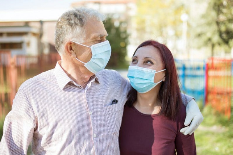 Older couple wearing face masks