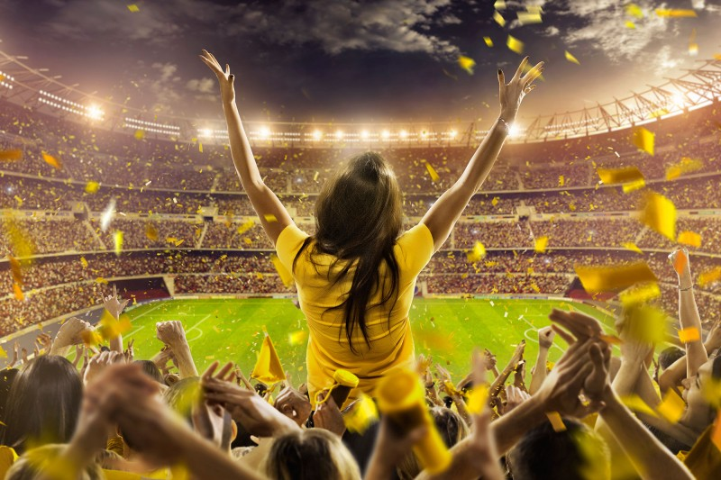 A woman celebrating in a sports stadium