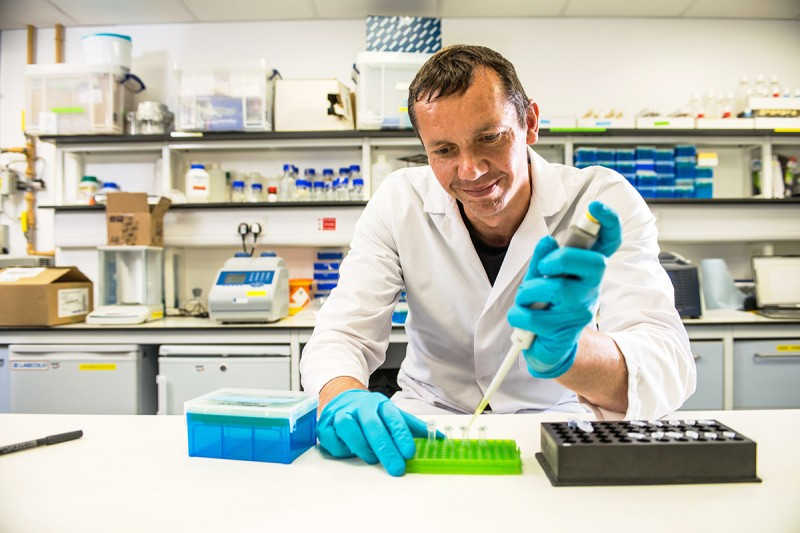 Portraits of Environmental Sciences students working in a lab