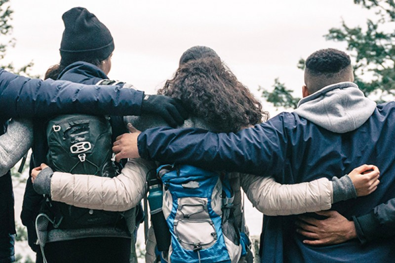 Group of young people with arms around
