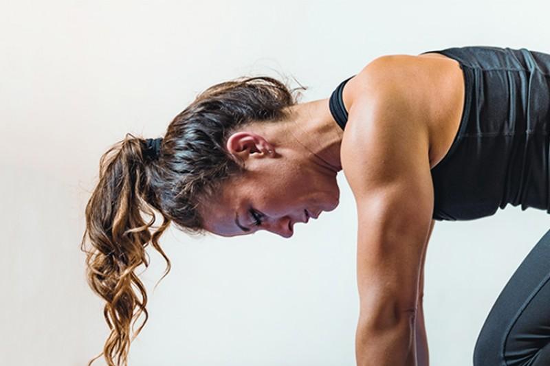 A woman exercising on a matt