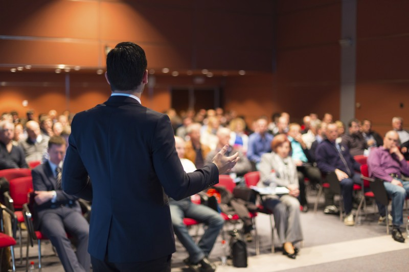 Man giving speech at conference