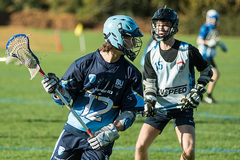 Male lacrosse player in a home shirt