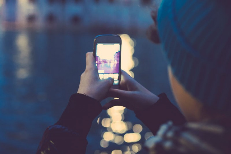 Young person taking photo on a mobile phone