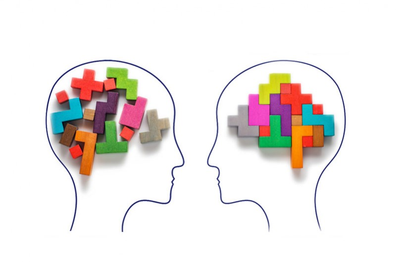 One head with jumbled tetris pieces and another with ordered tetris pieces