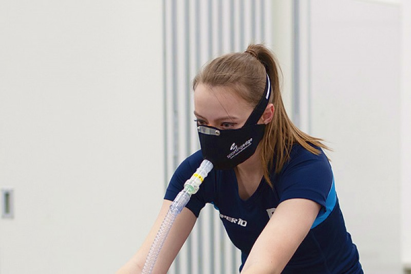 Image of a young woman using altitude training equipment