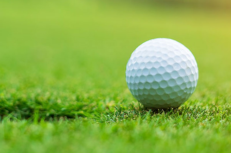 Image of a golf ball on a putting green