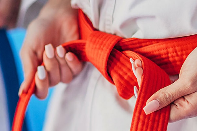 A blue and red karate belt