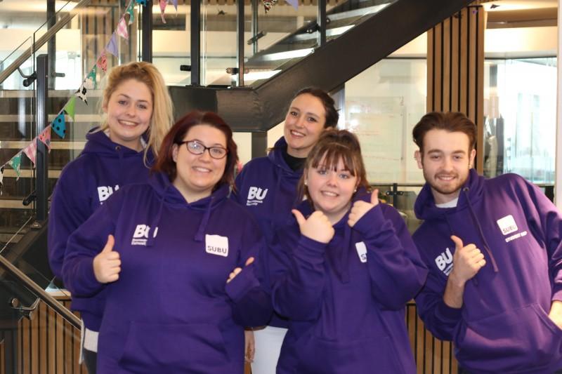 Group iof SUBU Student Reps in purple hoodies